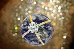 De aarde bond met lint met bokehachtergrond Stock Foto's