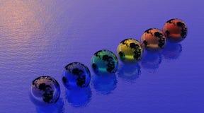 De aarde van de regenboog op oceaan Royalty-vrije Stock Foto