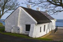 17 de abril de 2018 as casas de campo irlandesas famosas no berbigão enfileiram no porto de Groomsport no condado para baixo Irla Imagens de Stock Royalty Free
