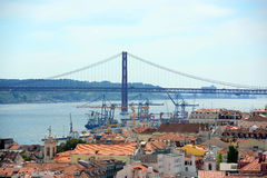25 de Abril Bridge and Alfama, Lisbon, Portugal Royalty Free Stock Photography
