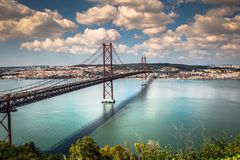 The 25 de Abril Bridge is a bridge connecting the city of Lisbon. To the municipality of Almada on the left bank of the Tejo river, Lisbon royalty free stock photo