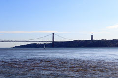 25 de Abril Bridge and Christ the King Statue Royalty Free Stock Photo