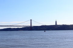 25 de Abril Bridge and Christ the King Statue Stock Photos