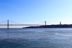 25 de Abril Bridge and Christ the King Statue Stock Image