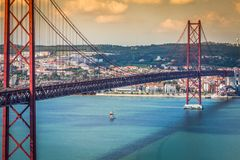 The 25 de Abril Bridge is a bridge connecting the city of Lisbon. To the municipality of Almada on the left bank of the Tejo river, Lisbon stock photo