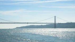 25 de Abril bridge in Lisbon, Portugal. A suspension bridge twin of the Golden Gate bridge stock video footage