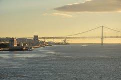 25 de Abril bridge. In Lisbon with Torre de Belém and Monumento alle Scoperte Stock Photography