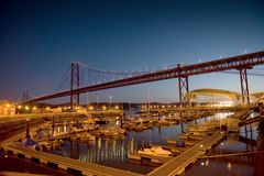The 25 de Abril Bridge and marine evening Stock Photography