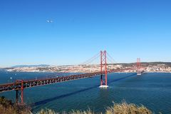 25 de Abril Bridge over the Tagus river, connecting Almada and Lisbon in Portugal.  Stock Photo