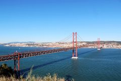 25 de Abril Bridge over the Tagus river, connecting Almada and Lisbon in Portugal.  Royalty Free Stock Image