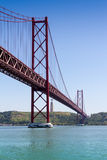 The 25 de Abril Bridge (Ponte 25 de Abril) is a suspension bridg Royalty Free Stock Image