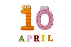 10 de abril en un fondo blanco de números y de letras Fotografía de archivo