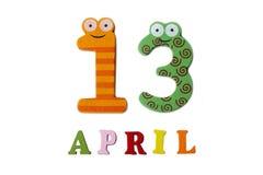 13 de abril en un fondo blanco de números y de letras Fotografía de archivo libre de regalías