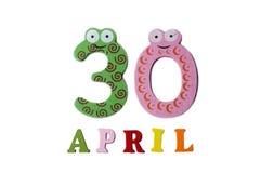 30 de abril en un fondo blanco de números y de letras Fotografía de archivo