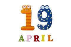 19 de abril en un fondo blanco de números y de letras Imagen de archivo libre de regalías