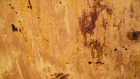 De abstracte achtergrond met het gat op het recht en de textuur van het roest oranje-bruin kleurden met vlekken Stock Foto