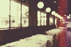 De abstracte achtergrond van het onduidelijk beeldrestaurant stock foto