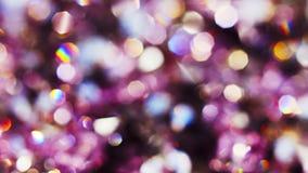 De abstracte achtergrond van kleuren bokeh cirkels in violette tonen stock footage