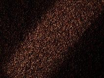 De abstracte achtergrond van koffiebonen Stock Fotografie