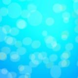 De abstracte blauwe achtergrond met defocused bokeh, onduidelijk beeldtextuur met Royalty-vrije Stock Afbeelding