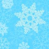 De abstracte blauwe achtergrond van Kerstmissneeuwvlokken Stock Foto
