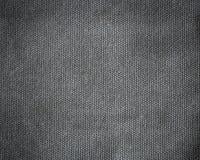 De abstracte donkere achtergrond van de canvastextuur Stock Afbeeldingen