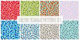 De abstracte geplaatste patronen van de Kerstmisdriehoek Rode, blauwe, groene, bruine, purpere vector de winter naadloze achtergr Stock Fotografie