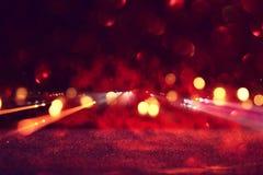 De abstracte Gloed van de Lens het conceptenbeeld van ruimte of de tijd reist achtergrond over donkere kleuren en verstralers Royalty-vrije Stock Foto