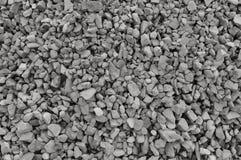 De abstracte grijze en beige achtergrond van de grintsteen, verpletterde grijze stenen en de textuur grote gedetailleerde horizon Stock Foto