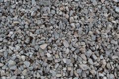 De abstracte grijze en beige achtergrond van de grintsteen, verpletterde grijze stenen en de textuur van granietstukken, grote ge Royalty-vrije Stock Afbeeldingen