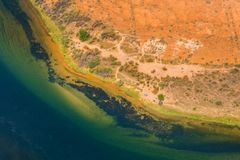 De abstracte kleurrijke banken van het de rivierzand van Colorado, natuurlijke textuur en achtergrond stock foto