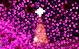De abstracte lichte achtergrond van de Kerstmisviering met defocused lichten Stock Afbeelding