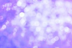 De abstracte Lichtpaarse Achtergrond van Lichten Defocussed Stock Foto