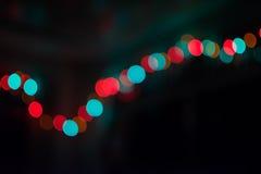 De abstracte Nacht Lichte Defocus Kleurrijke Bokeh van het Partijonduidelijke beeld op Zwarte Achtergrond Stock Foto's