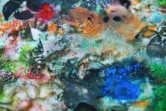 De abstracte oranje roze zwarte kleuren en de tinten van de mengelingsverf Abstracte unieke natte verfachtergrond Schilderende vl Royalty-vrije Stock Afbeelding