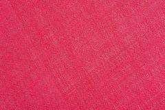 De abstracte rode achtergrond van de stoffentextuur Ecologisch streepbehang royalty-vrije stock afbeeldingen