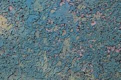 De achtergrond bestaat uit een concrete muuroppervlakte met schilverf stock fotografie