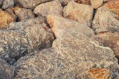 De achtergrond en de textuur van de rots Stock Afbeeldingen