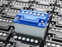 De achtergrond van autobatterijen. Blauwe accumulatoren. Stock Foto