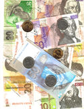 De achtergrond van bankbiljetten en van muntstukken Stock Foto