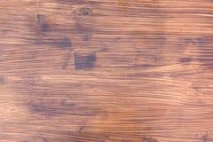 De achtergrond van bruine houten Raad op wie de lijnen van de boom zichtbaar zijn royalty-vrije stock afbeeldingen