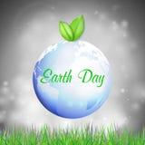 De achtergrond van de aardedag met de woorden, de blauwe planeet, de groene bladeren en het gras Vector illustratie Royalty-vrije Stock Foto