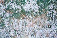 De achtergrond van de de muurtextuur van Grunge Verf die van donkere muur met roest barsten onderaan Royalty-vrije Stock Afbeeldingen