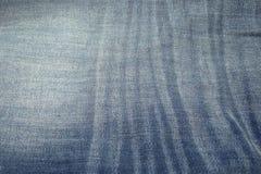 De achtergrond van de jeansstof Stock Afbeeldingen