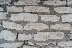 De achtergrond van de kalksteenbakstenen muur in hoge resolutie Royalty-vrije Stock Foto's