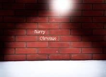 De achtergrond van de Kerstmisbakstenen muur met de vorm van de santahoed, kaart Royalty-vrije Stock Afbeelding