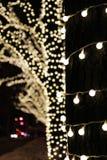 De achtergrond van de Kerstmisdecoratie met lichten het gloeien Royalty-vrije Stock Afbeelding
