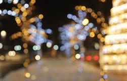 De achtergrond van de Kerstmisdecoratie met lichten het gloeien Stock Afbeelding