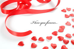 De achtergrond van de liefde. Klein harten en lint Royalty-vrije Stock Foto's
