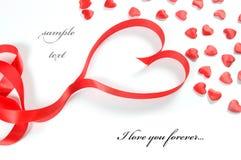 De achtergrond van de liefde. Klein harten en lint Stock Afbeeldingen